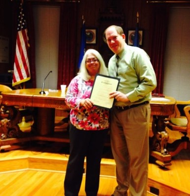 Mayor Grim Presents a Proclamation to Becky Mcclarran of Mcclarran and Williams, Inc.